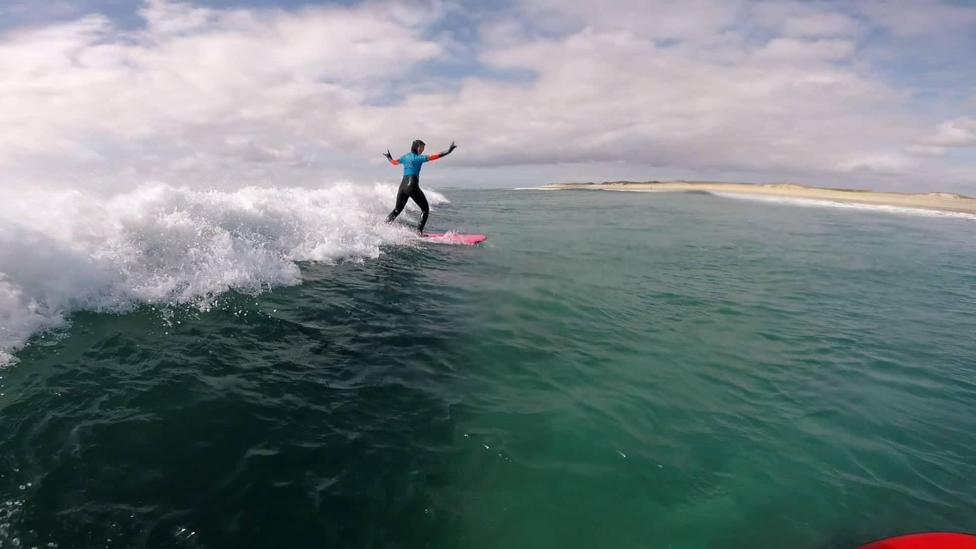 Tonn Nua surf school guy surfing